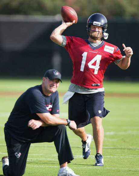 Under the watchful eye of Texans coach Bill O'Brien, quarterback Ryan Fitzpatrick goes through his paces during the team's first practice of training camp Saturday. O'Brien has named Fitzpatrick the starter. Photo: Brett Coomer, Staff / © 2014 Houston Chronicle