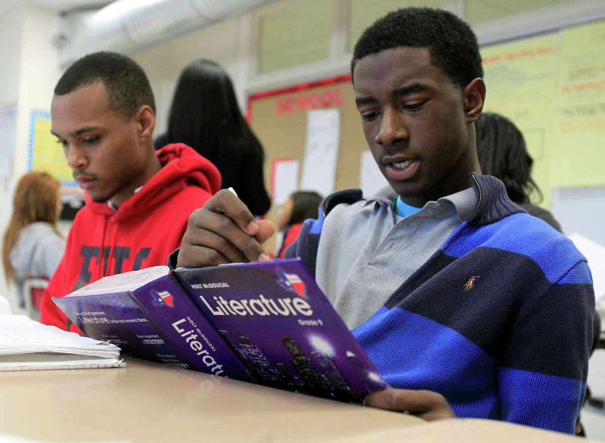 Ninth-grader Davonte Holcombe, right, reads a short story, out loud, in Shondrell Richardson's reading class at Furr High School, Wednesday, March 12, 2014, in Houston. ( Karen Warren / Houston Chronicle )