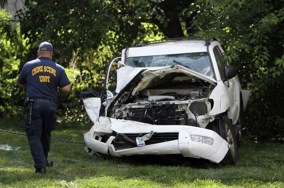 The stolen SUV ended up smashed against trees about a mile from the carjacking scene in Philadelphia. Photo: Joseph Kaczmarek / Associated Press / FR109827 AP