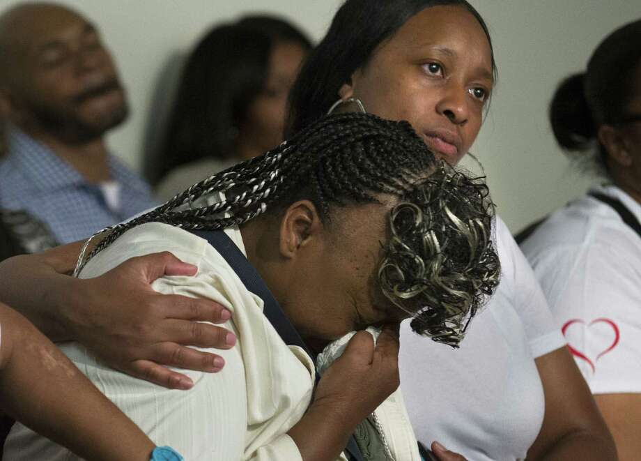 Gwen Carr, mother of Eric Garner, is comforted by his wife, Esaw, during a gathering Saturday. Photo: John Minchillo / Associated Press / FR170537 AP