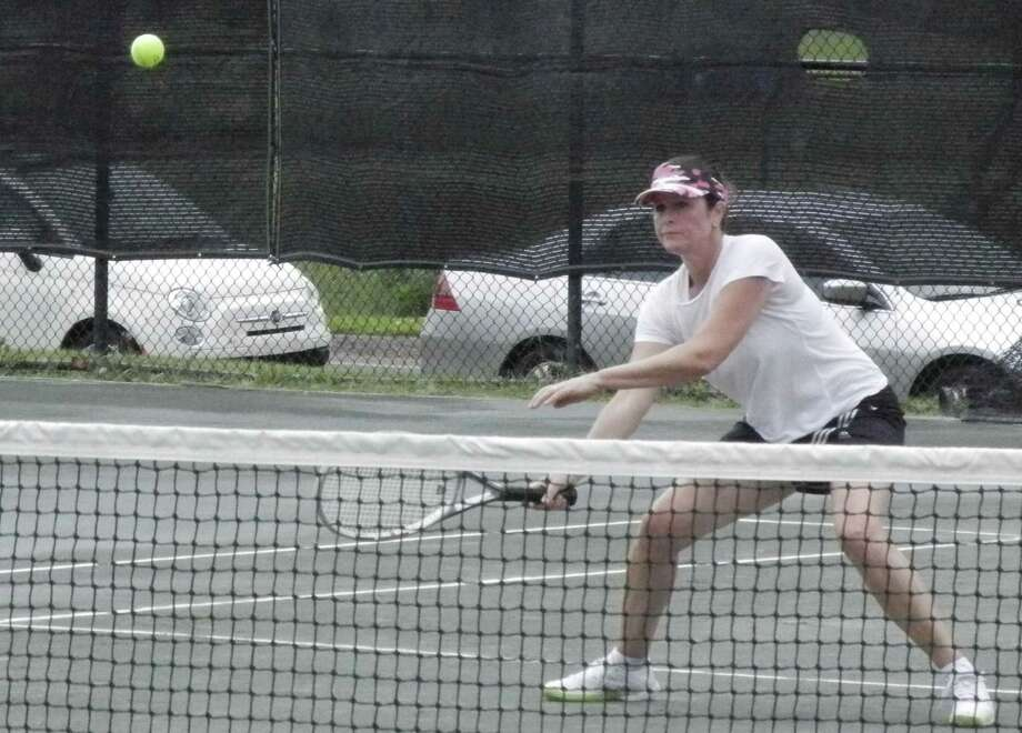 Ginny Greatsinger returns a shot on her way to the women's open championship in the Fairfield Town Tennis Tournament on Saturday, July 26 at the Old Dam Road courts at Fairfield Indoor Tennis. She defeated Wendy Minter Griffin 6-2, 6-1 in the division final. Photo: Reid L. Walmark / Fairfield Citizen