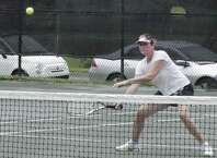 Ginny Greatsinger returns a shot on her way to the women's open championship in the Fairfield Town Tennis Tournament on Saturday, July 26 at the Old Dam Road courts at Fairfield Indoor Tennis. She defeated Wendy Minter Griffin 6-2, 6-1 in the division final.