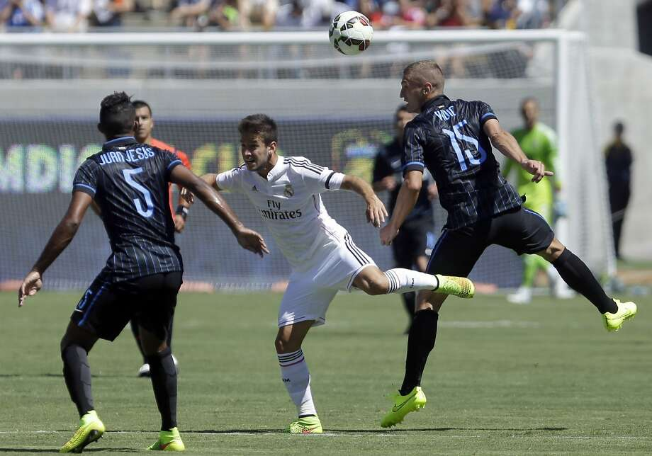 Inter Milan's Nemanja Vidic (right) gets to the ball ahead of Real Madrid's Alvaro Medran. Vidic later scored Inter's goal. Photo: Ben Margot, Associated Press