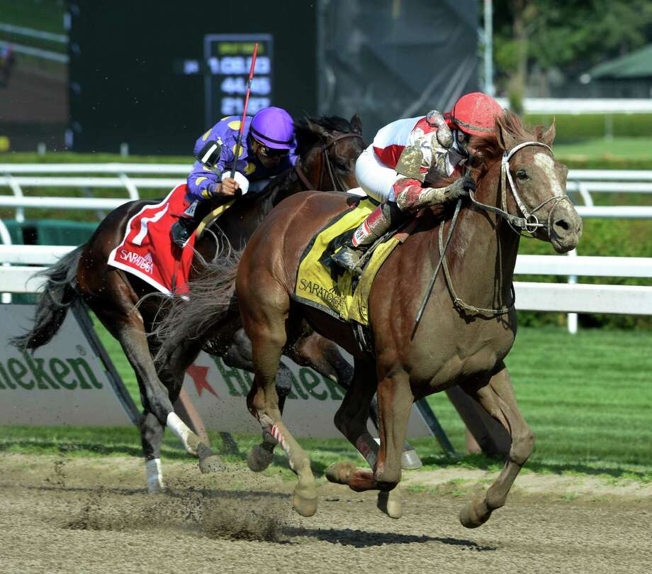 Coup de Grace with jockey Rosie Napranik out distanced C. Zee with jockey Luis Saez  Saturday afternoon July 26, 2014 to win the 22nd running of The Amsterdam at the Saratoga Race Course in Saratoga Springs, N.Y.    (Skip Dickstein / Times Union) Photo: SKIP DICKSTEIN
