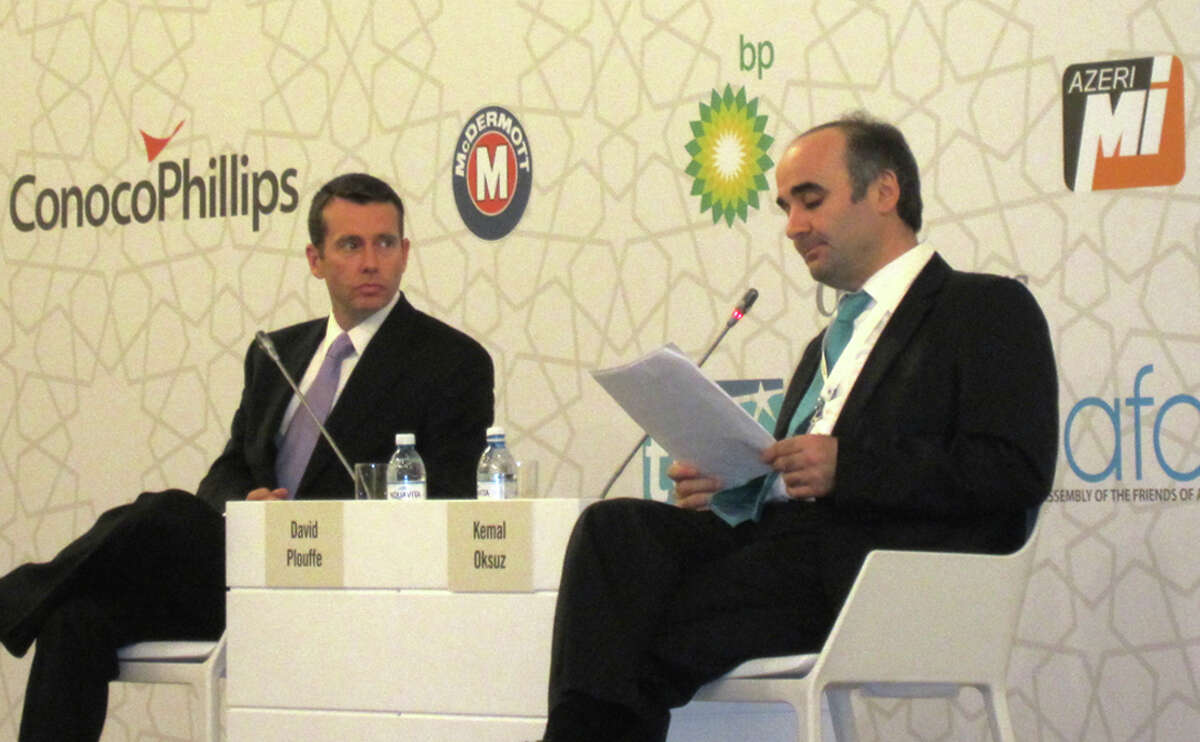 The conference in Azerbaijan's capital included a discussion by Kemal Oksuz, right, with President Barack Obama's 2008 campaign manager, David Plouffe.