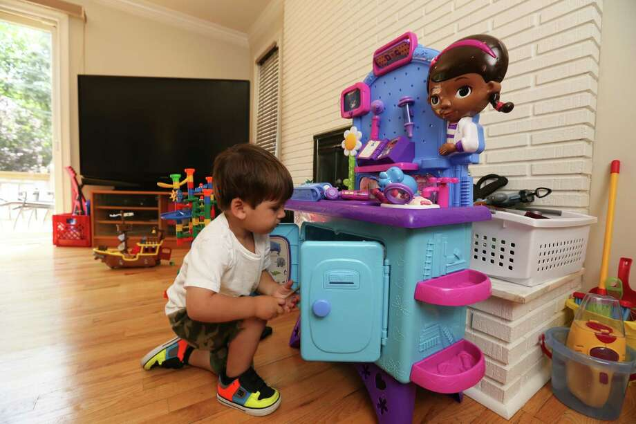 More children like Nathan Lipschik, 2, play with toys targeted to children of other racial groups, a trend that reflects the country's demographics. Photo: CHESTER HIGGINS JR., STF / NYTNS