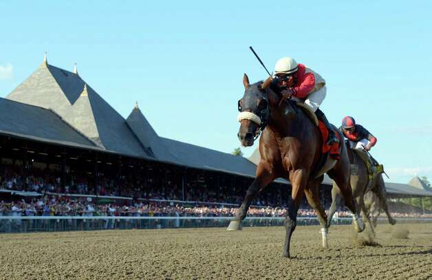 Wicked Strong with jockey Rajiv Maragh wins the 51st running of the Jim Dandy Saturday afternoon July 26, 2014 at the Saratoga Race Course in Saratoga Springs, N.Y.    (Skip Dickstein / Times Union) Photo: SKIP DICKSTEIN
