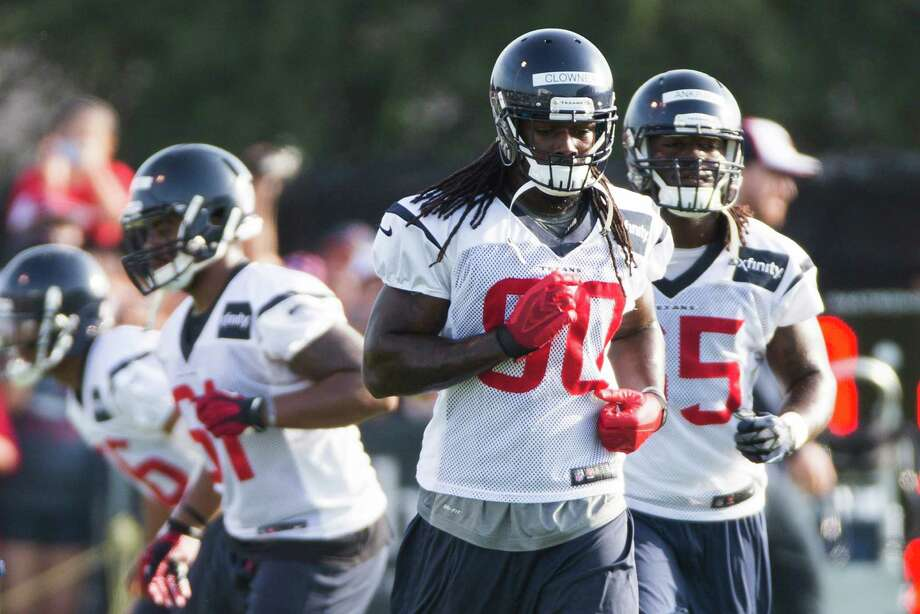 Texans outside linebacker Jadeveon Clowney (90) hit the field with his teammates Saturday, but the rookie is limited in what he can do as he gets up to speed after undergoing surgery in June to repair a sports hernia. Photo: Brett Coomer, Staff / © 2014 Houston Chronicle
