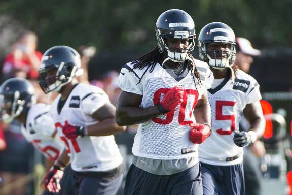 Texans outside linebacker Jadeveon Clowney (90) hit the field with his teammates Saturday, but the rookie is limited in what he can do as he gets up to speed after undergoing surgery in June to repair a sports hernia.