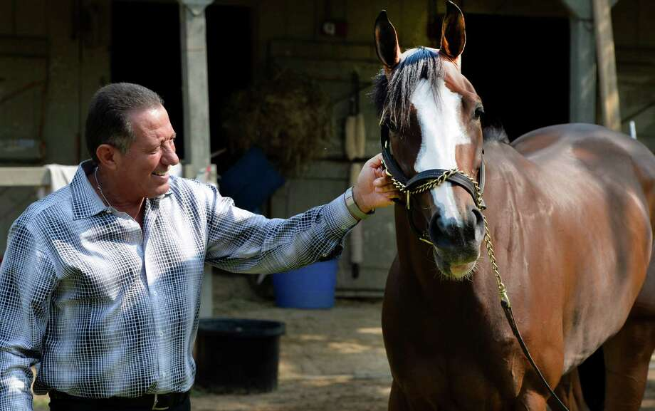 Owner Roddy Valente holds Hot Stones Friday morning July 25, 2014 at the Oklahoma Training Center in Saratoga Springs, N.Y.      (Skip Dickstein / Times Union) Photo: SKIP DICKSTEIN
