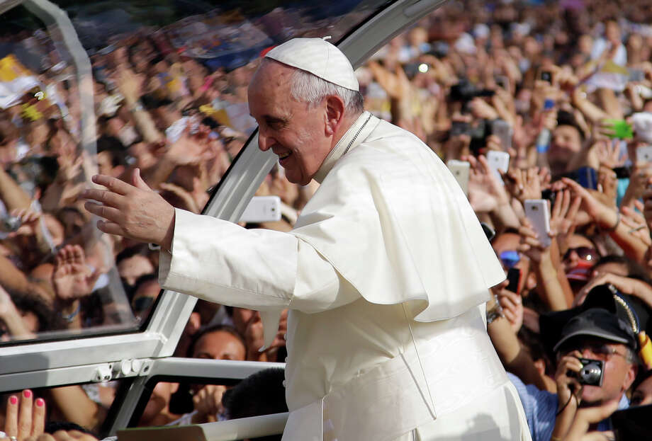 Pope Francis arrives to celebrate a mass in Caserta, Italy, Saturday, July 26, 2014. Pope Francis will remain in Caserta for a few hours, but will be back here for a private visit on Monday. (AP Photo/Gregorio Borgia) Photo: Gregorio Borgia, STF / AP