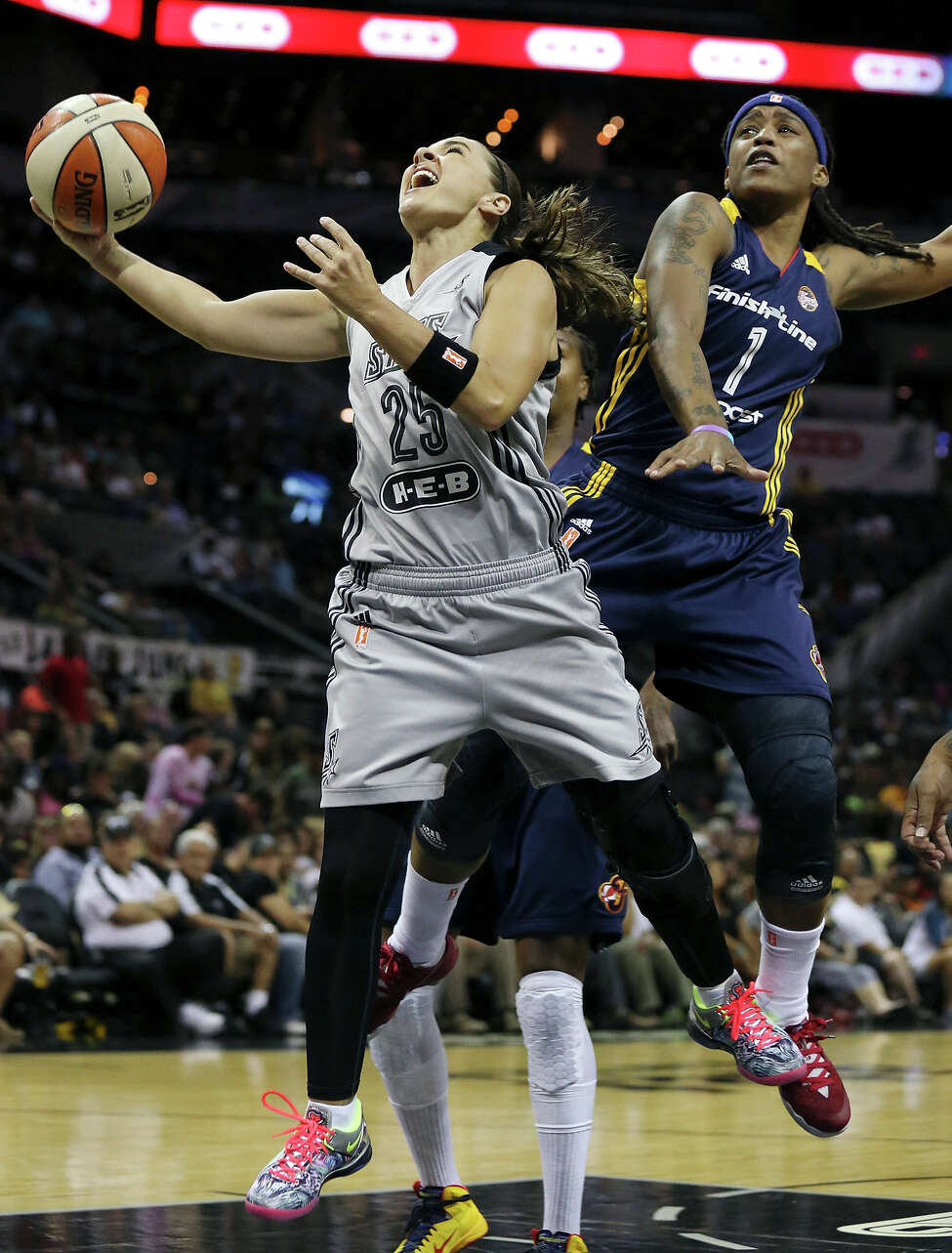 San Antonio Stars' Becky Hammon is fouled by Indiana Fever's Shavonte Zellous during first half action Saturday July 26, 2014 at the AT&T Center.