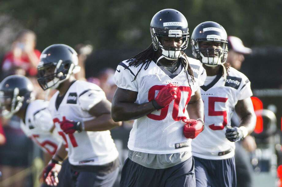 Texans rookie Jadeveon Clowney (center) is recovering from sports hernia surgery he underwent June 12. A defensive end at South Carolina, he is moving to linebacker in the pros. Photo: Brett Coomer / Houston Chronicle / © 2014 Houston Chronicle