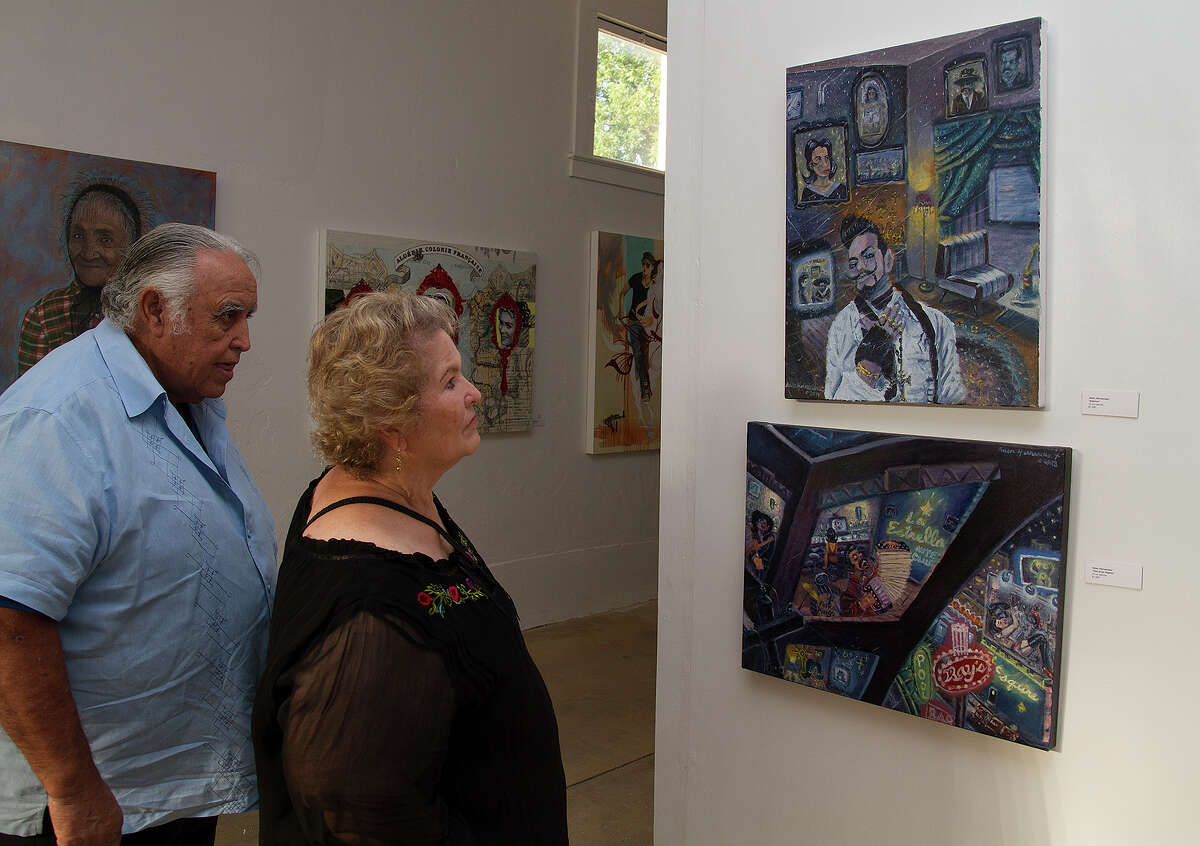 Joe and Rosie Zertuche at the inaugural exhibition of Eco y Voces del Arte, a new exhibition space by Mexican folk artist Veronica Castillo, Saturday, July 26, 2014.