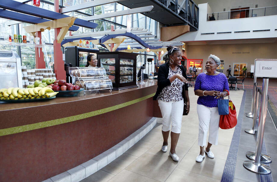 Nechia Pendleton (left) of Oklahoma City and Nellie Waters of San Antonio leave El Puente Cafe inside the Convention Center last week. The deadline to submit a proposal for the facility's concession and catering contract is Aug. 29. Photo: Photos By Cynthia Esparza / For The San Antonio Express-News / © 2014 San Antonio Express-News