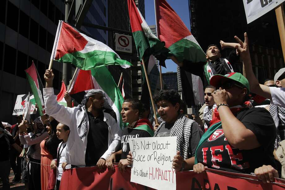 Protesters chant and march together down Market street during a march through downtown following a rally against the ongoing violence in Palestine organized by the Arab Resource and Organizing Center (AROC), the American Muslims for Palestine (AMP) and the ANSWER Coalition July 26, 2014 in San Francisco, Calif. Photo: Leah Millis, The Chronicle