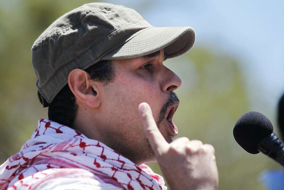 Hani Jamah, 41, of San Jose, speaks to a crowd about losing 40 family members in Gaza over the past three weeks during a rally and protest against the ongoing violence in Palestine organized by the Arab Resource and Organizing Center (AROC), the American Muslims for Palestine (AMP) and the ANSWER Coalition July 26, 2014 on the Embarcadero in San Francisco, Calif. Photo: Leah Millis, The Chronicle