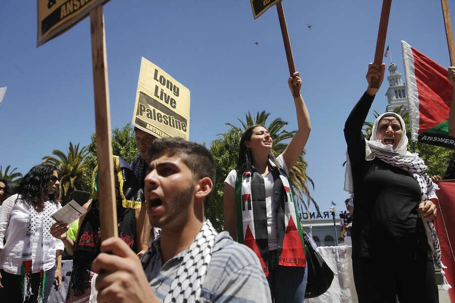 "People chant ""free free Palestine!"" during a rally and protest against the ongoing violence in Palestine organized by the Arab Resource and Organizing Center (AROC), the American Muslims for Palestine (AMP) and the ANSWER Coalition July 26, 2014 on the Embarcadero in San Francisco, Calif. Photo: Leah Millis, The Chronicle"