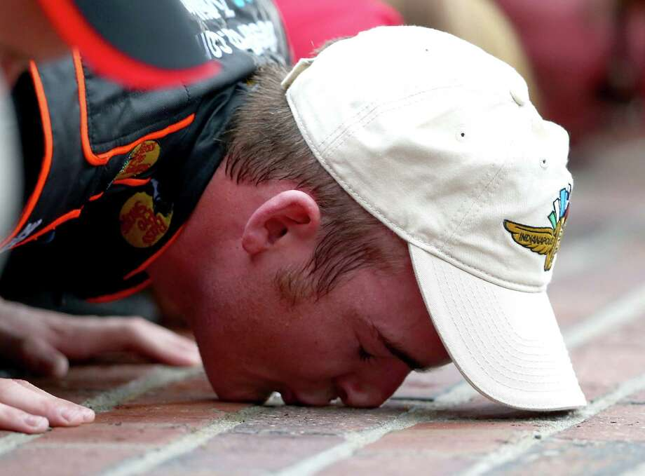 Ty Dillon celebrates his victory in the Nationwide Series race at Indianapolis Motor Speedway by kissing the bricks - a tradition at the storied venue - at the finish line. Photo: Andy Lyons, Staff / 2014 Getty Images
