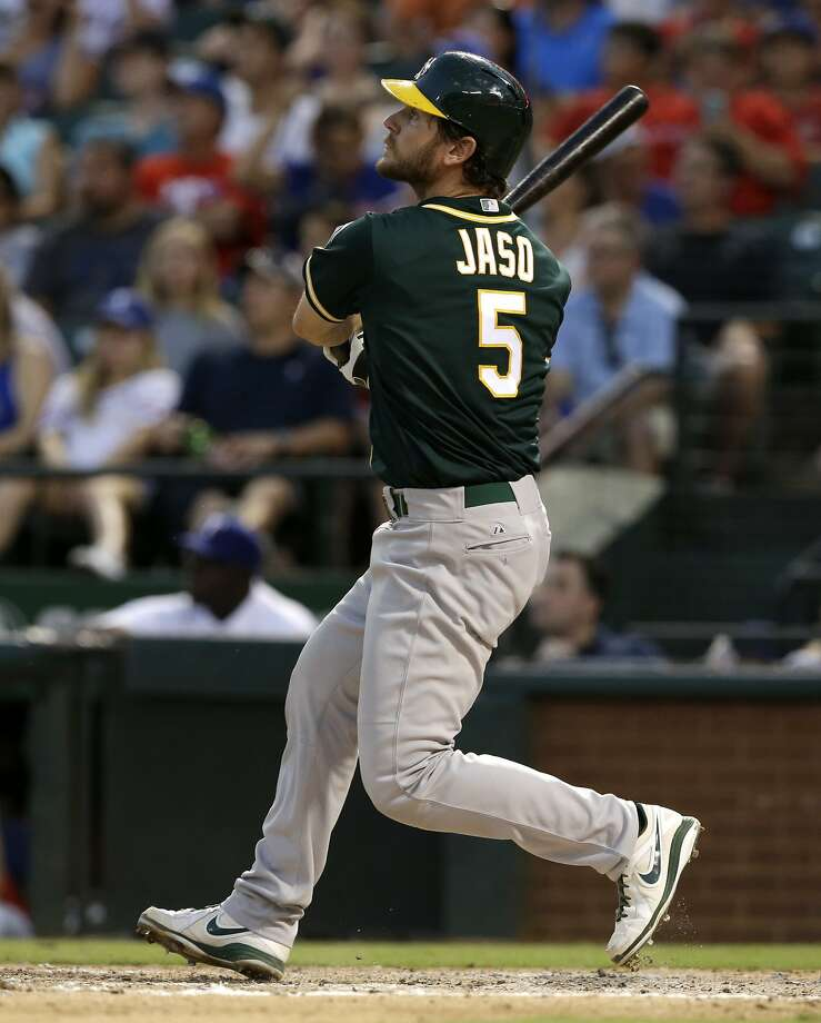 John Jaso belts a homer in the sixth, one of four A's long balls in a two-inning span. Photo: Tony Gutierrez, Associated Press