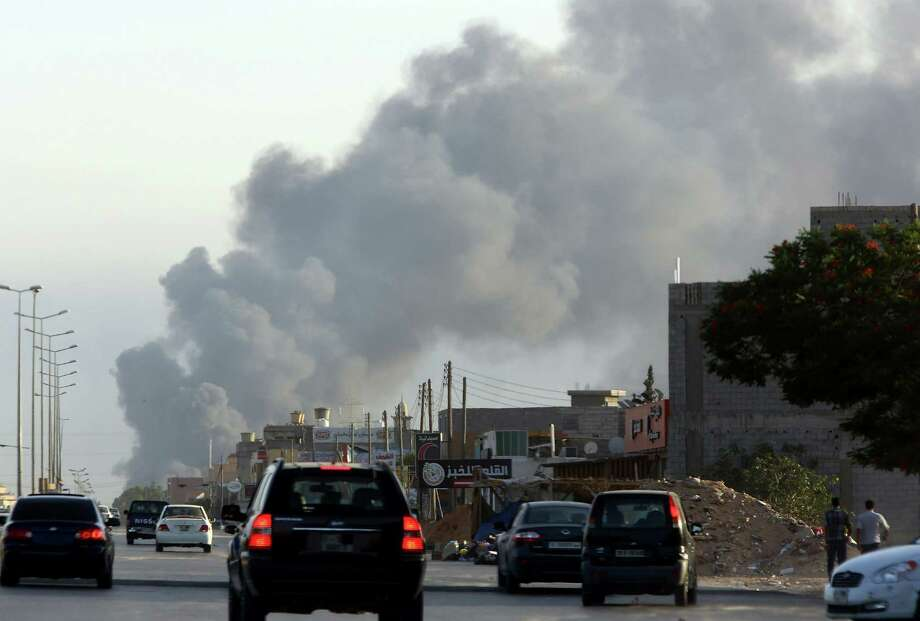 """The United States evacuated its Libyan embassy staff under air cover Saturday, saying they faced a """"real risk"""" from fierce fighting around a Tripoli airport. Photo: MAHMUD TURKIA, Stringer / AFP"""