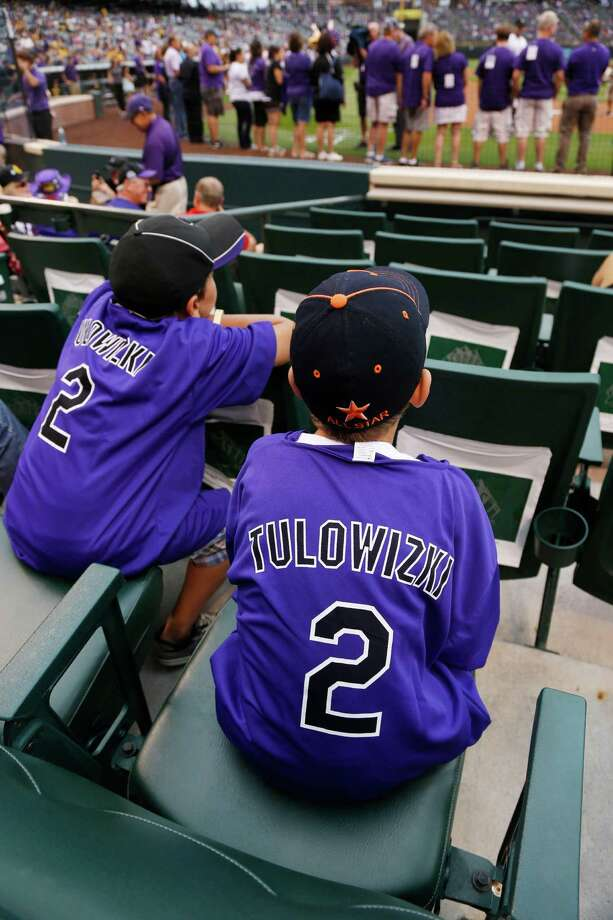 Young fans wear misspelled jerseys given to fans with the name of Colorado Rockies All-Star shortstop Troy Tulowitzki before a Rockies against the Pittsburgh Pirates baseball game in Denver, Saturday, July 26, 2014. (AP Photo/David Zalubowski) ORG XMIT: CODZ103 Photo: David Zalubowski / AP