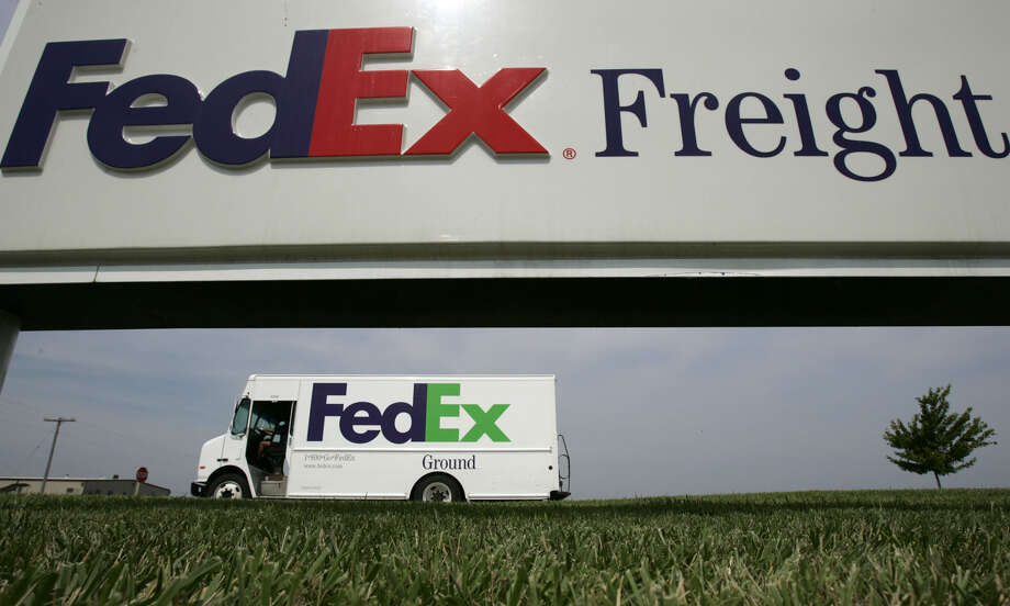 File - This June 21, 2005 file photo shows a Federal Express delivery truck leaving a FedEx distribution terminal in Edwardsville, Kan. FedEx Corp. is under criminal indictment and facing $1.6 billion in penalties for allegedly failing to police the activities of illegal online pharmacies that use the shipping service to deliver prescription drugs. (AP Photo/Charlie Riedel, File) Photo: Charlie Riedel, STF / AP