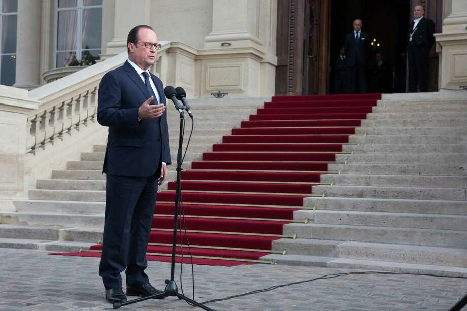 French President Francois Hollande delivers a speech outside the Foreign Affairs ministry in Paris, Saturday, July 26, 2014, after meeting families of the victims of Air Algeria flight crash, that killed all 118 people onboard including 54 French citizens. (AP Photo/Philippe Wojazer, Pool) Photo: Philippe Wojazer, POOL / Reuters Pool