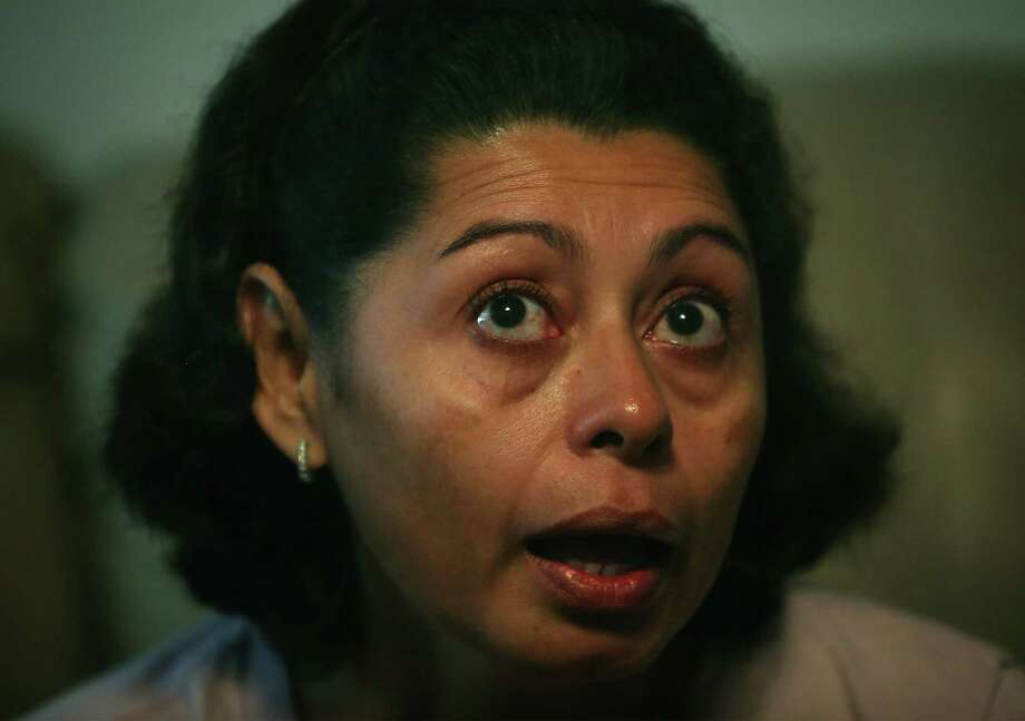 Lesly Cabrera and her teen son came from Honduras in the spring. Current laws likely will allow her son to stay in the U.S. legally, but Cabrera probably will be ordered to return home. Photo: Bob Owen / San Antonio Express-News / © 2012 San Antonio Express-News