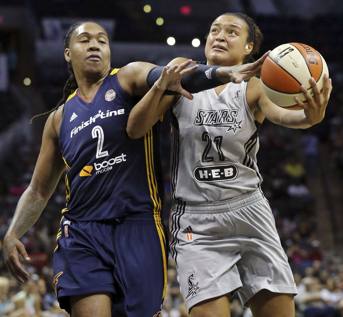 Indiana's Erlana Larkins (left) fouls the Stars' Kayla McBride during the first half Saturday at the AT&T Center. McBride finished with nine points in 29 minutes of action.