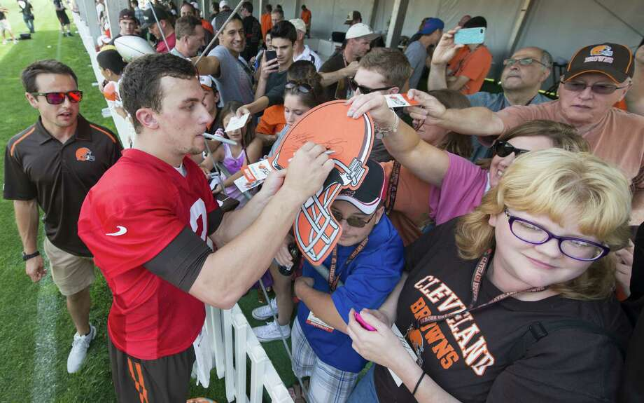 Browns fans flock to get Johnny Manziel's autograph after the first day of training camp Saturday in Berea, Ohio. Photo: Jason Miller / Getty Images / 2014 Getty Images