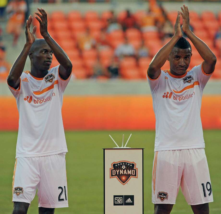 New Houston Dynamo players DaMarcus Beasley, left, and Luis Garrido acknowledge the crowd after being introduced before the BBVA Compass Dynamo Charities Cup against Aston Villa, Saturday, July 26, 2014, at BBVA Compass Stadium in Houston. Photo: Eric Christian Smith, For The Chronicle / Eric Christian Smith
