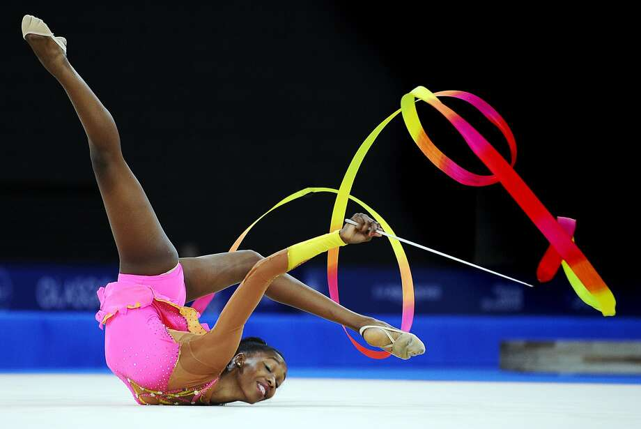 TOPSHOTS South Africa's Grace Legote competes in the women's rhythmic gymnastics individual ribbon final at The SECC Precinct during the 2014 Commonwealth Games in Glasgow, Scotland, July 26, 2014. AFP PHOTO / ANDY BUCHANANAndy Buchanan/AFP/Getty Images Photo: Andy Buchanan, AFP/Getty Images