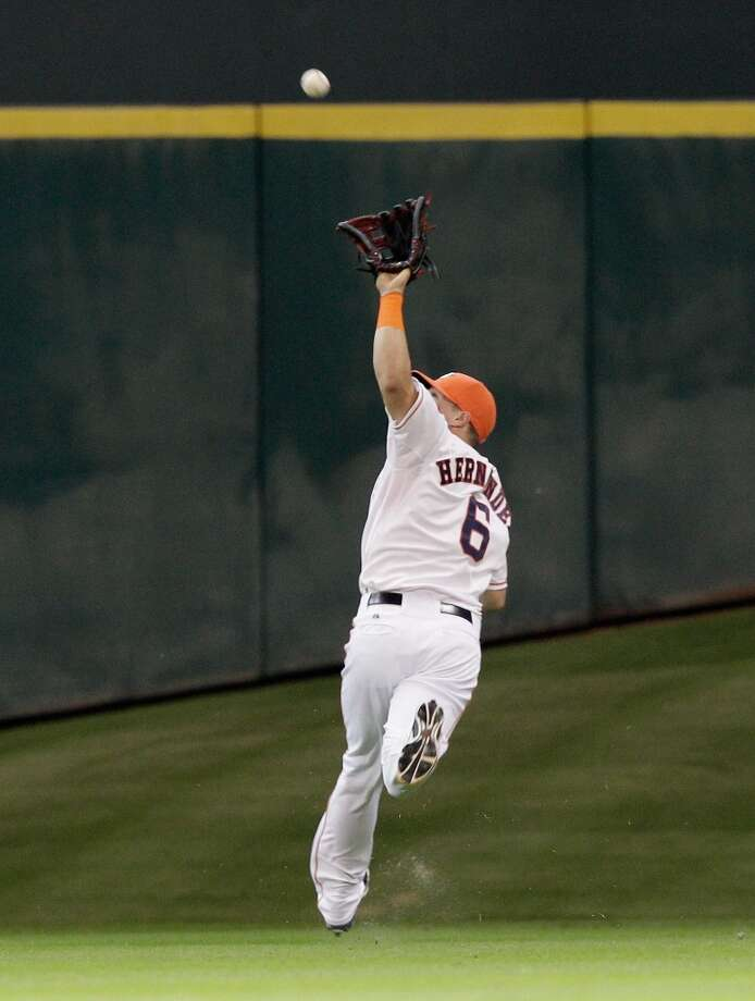 Enrique Hernandez makes an over the shoulder catch in the second inning. Photo: Bob Levey, Getty Images