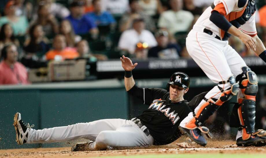 Miami's Christian Yelich scores in the second inning. Photo: Bob Levey, Getty Images
