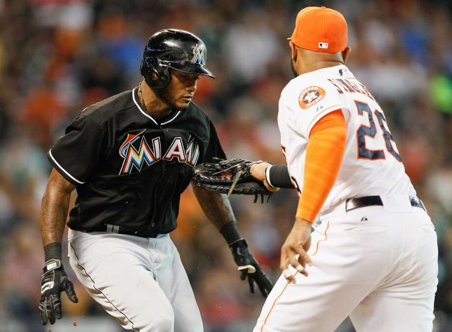 Miami's Jordany Valdespin is tagged out by Jon Singleton in the fourth inning. Photo: Bob Levey, Getty Images