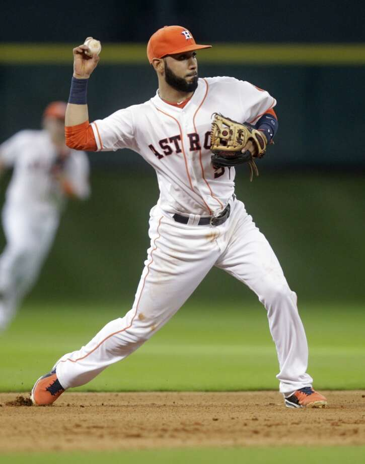 Marwin Gonzalez fields a ball during the fourth inning. Photo: Patric Schneider, Associated Press