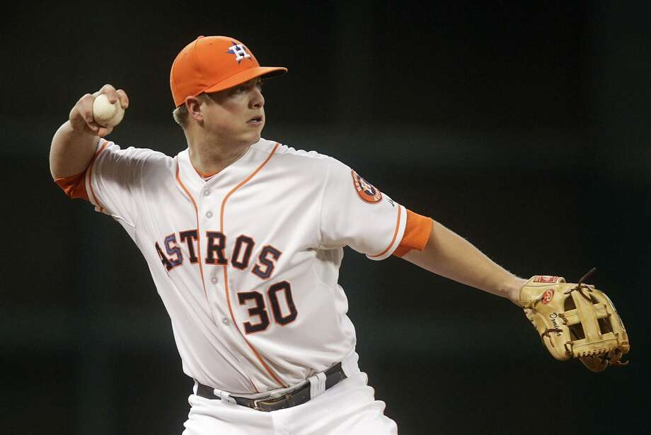 Astros third baseman Matt Dominguez fields a ball during the fourth inning. Photo: Patric Schneider, Associated Press