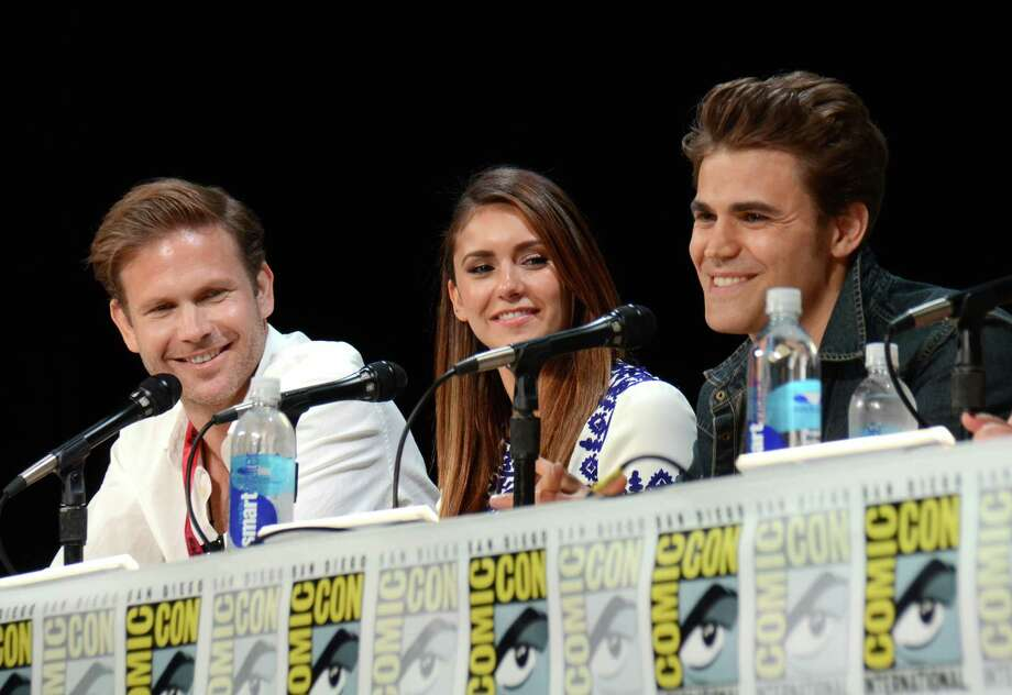 "Matthew Davis, from left, Nina Dobrev and Paul Wesley attend the ""Vampire Diaries"" panel on Day 3 of Comic-Con International on Saturday, July 26, 2014, in San Diego. Photo: Tonya Wise, Tonya Wise/Invision/AP / AP2014"