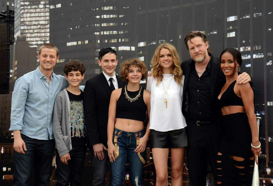 "Benjamin McKenzie, from left, David Mazouz, Robin Taylor, Camren Bicondova, Erin Richards, Donal Logue, and Jada Pinkett Smith pose at the ""Gotham"" press line on Day 3 of Comic-Con International on Saturday, July 26, 2014, in San Diego. (Photo by Tonya Wise/Invision/AP) Photo: Tonya Wise, Tonya Wise /Invision/AP / AP2014"