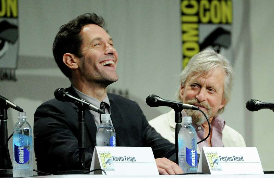 "Paul Rudd, left, and Michael Douglas, cast members in the upcoming Marvel film ""Ant-Man,"" take part in the Marvel panel at Comic-Con International on Saturday, July 26, 2014 in San Diego, Calif. (Photo by Chris Pizzello/Invision/AP) Photo: Chris Pizzello, Chris Pizzello /Invision/AP / AP2014"