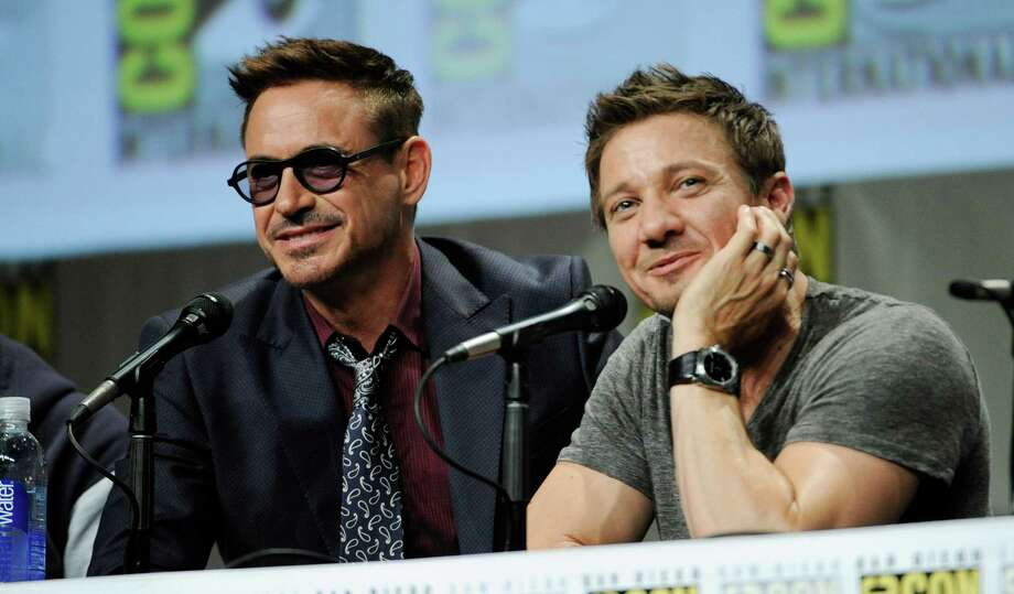 Actors Robert Downey Jr., left, and Jeremy Renner take part in the Marvel panel at Comic-Con International on Saturday, July 26, 2014, in San Diego. (Photo by Chris Pizzello/Invision/AP) Photo: Chris Pizzello, Chris Pizzello /Invision/AP / AP2014