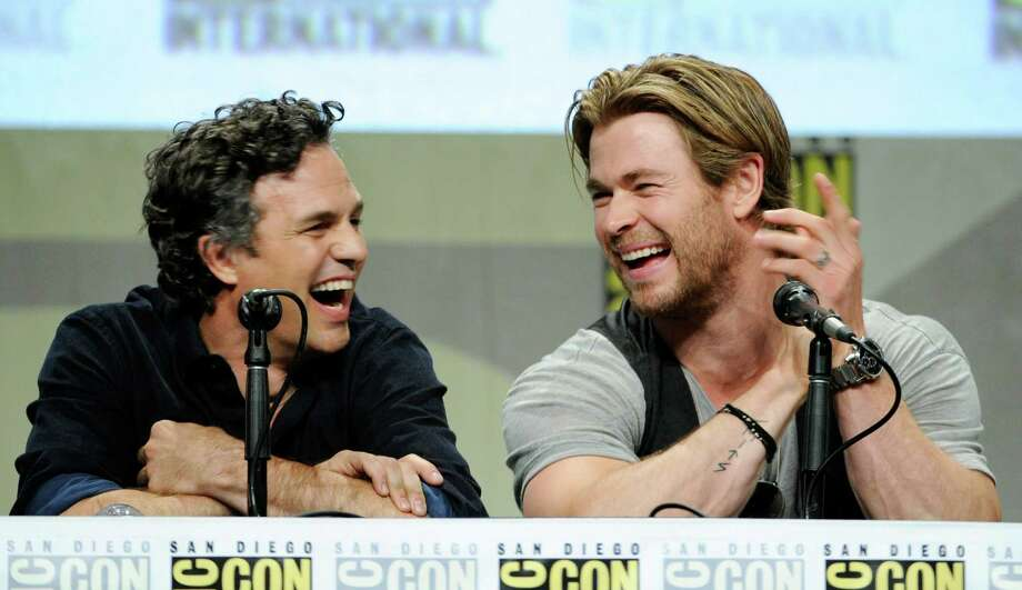 Actors Mark Ruffalo, left, and Chris Hemsworth laugh during the Marvel panel at Comic-Con International on Saturday, July 26, 2014, in San Diego. (Photo by Chris Pizzello/Invision/AP) Photo: Chris Pizzello, Chris Pizzello /Invision/AP / AP2014