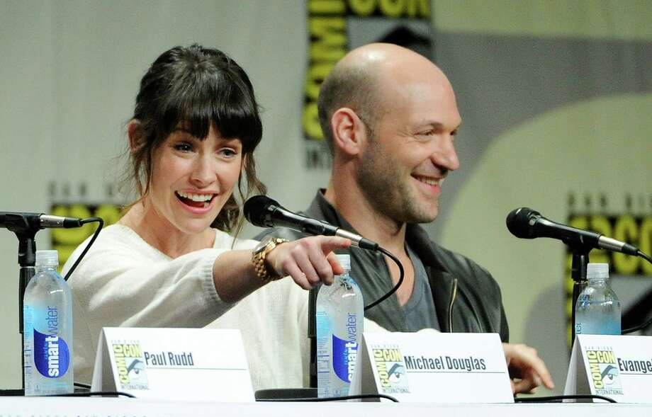 "Evangeline Lilly, left, and Corey Stoll, cast members in the upcoming Marvel film ""Ant-Man,"" take part in the Marvel panel at Comic-Con International on Saturday, July 26, 2014, in San Diego. (Photo by Chris Pizzello/Invision/AP) Photo: Chris Pizzello, Chris Pizzello /Invision/AP / AP2014"