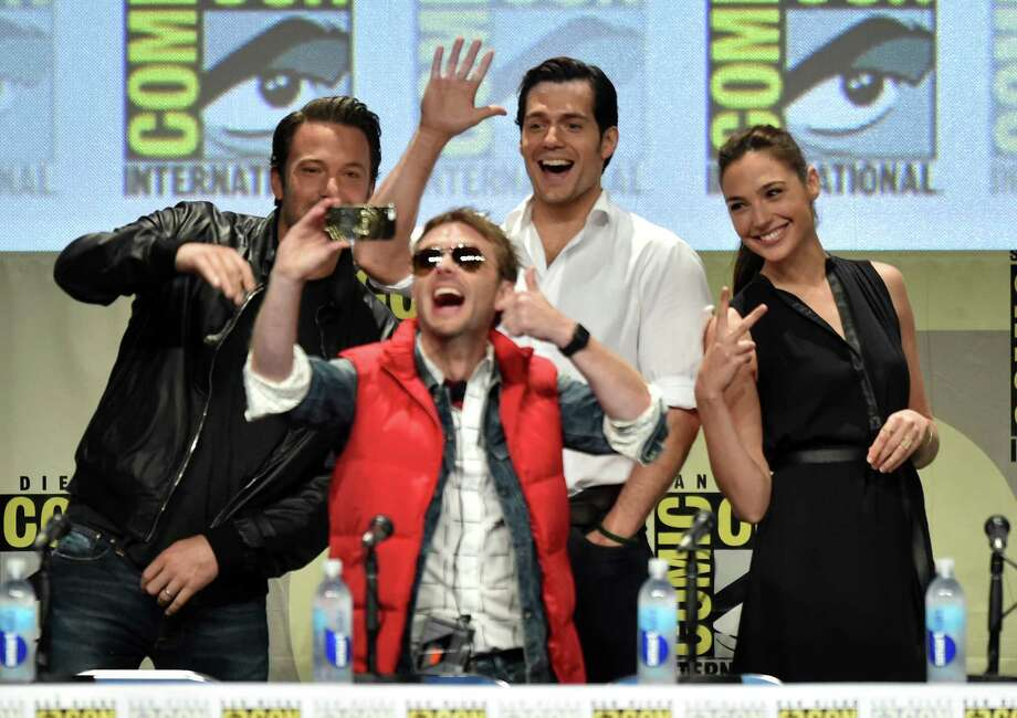 SAN DIEGO, CA - JULY 26:  (L-R) Moderator Chris Hardwick takes a selfie with actors Ben Affleck, Henry Cavill and Gal Gadot at the Warner Bros. Pictures panel and presentation during Comic-Con International 2014 at San Diego Convention Center on July 26, 2014 in San Diego, California. Photo: Kevin Winter, Getty Images / 2014 Getty Images