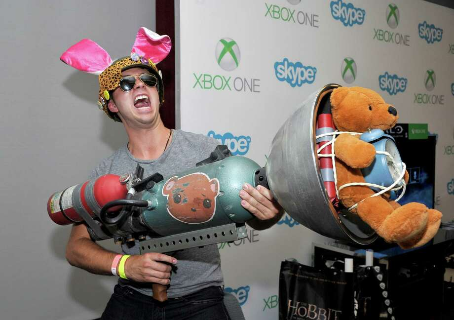 SAN DIEGO, CA - JULY 26:  'Teen Wolf' actor Stephen Lunsford snaps a photo with Sunset Overdrive's TNT Teddy in the Microsoft VIP Lounge during Comic-Con July 26, 2014 in San Diego, California. Photo: John Sciulli, Getty Images For Xbox / 2014 Getty Images