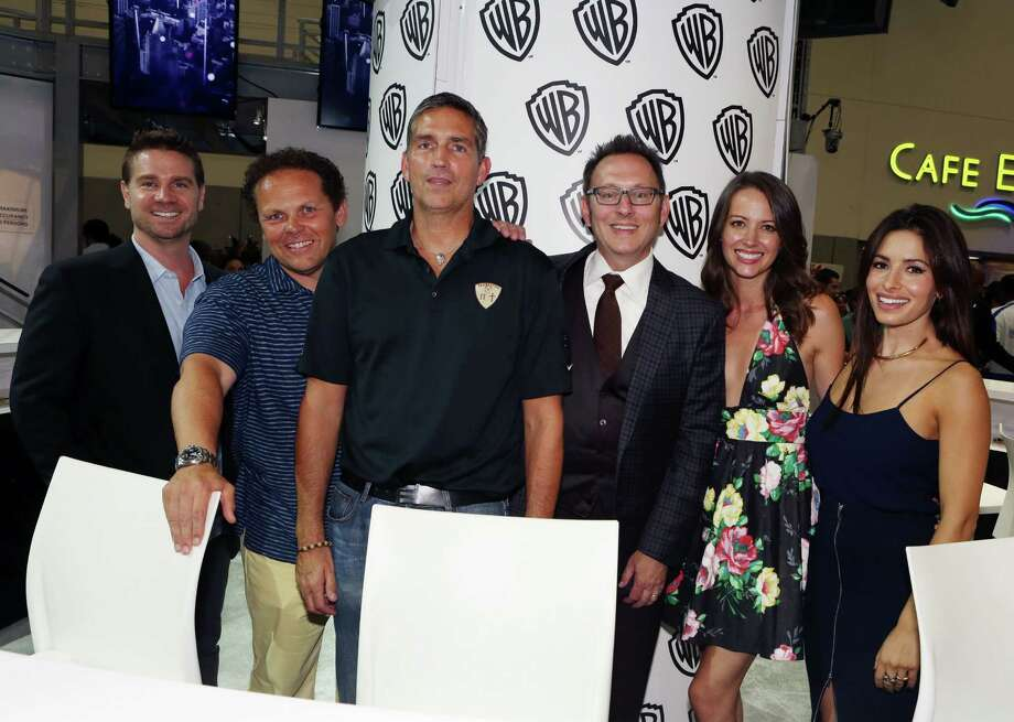 "SAN DIEGO, CA - JULY 26:  In this handout photo provided by Warner Bros, Greg Plageman, Kevin Fusco, Jim Caviezel, Michael Emerson, Amy Acker, and Sarah Shahi of ""Person of Interest"" attend Comic-Con International 2014 on July 26, 2014  in San Diego, California. Photo: Handout, Getty Images / 2014 Warner Bros. Entertainment"