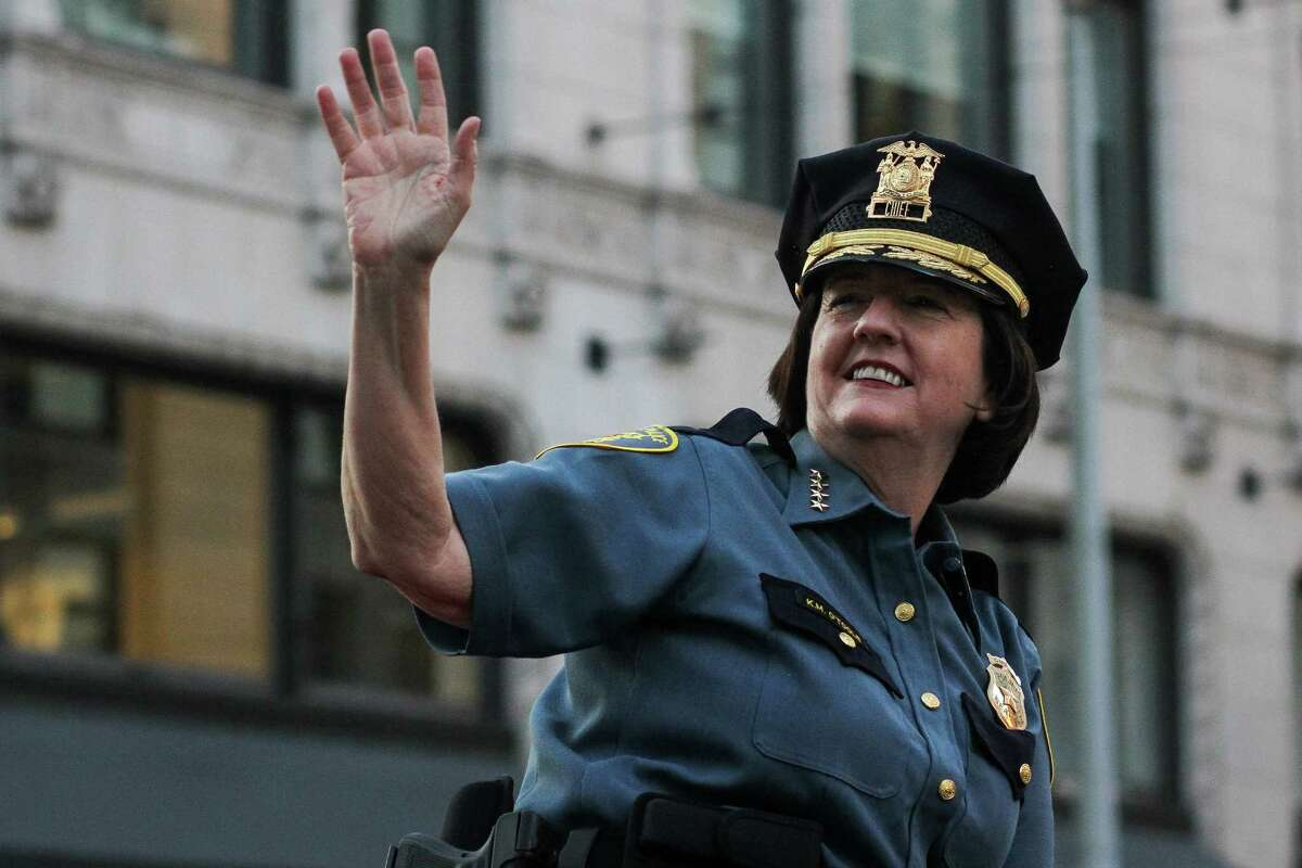 Seattle Police Chief Kathleen O'Toole, pictured at the 2014 Torchlight Parade, has agreed to meet with Officer Raleigh Evans to discuss off-duty work by the department's officers.
