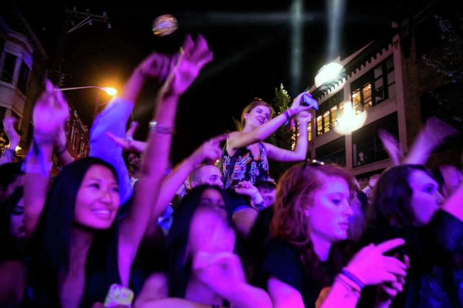 Onlookers watch Chromeo perform on the main stage on the second of three days of the annual Capitol Hill Block Party Saturday, July 26, 2014, in Seattle, Wash. Spanning six blocks of the Seattle neighborhood, the festival features local and nationally acclaimed bands on six different stages. Photo: JORDAN STEAD, SEATTLEPI.COM / SEATTLEPI.COM