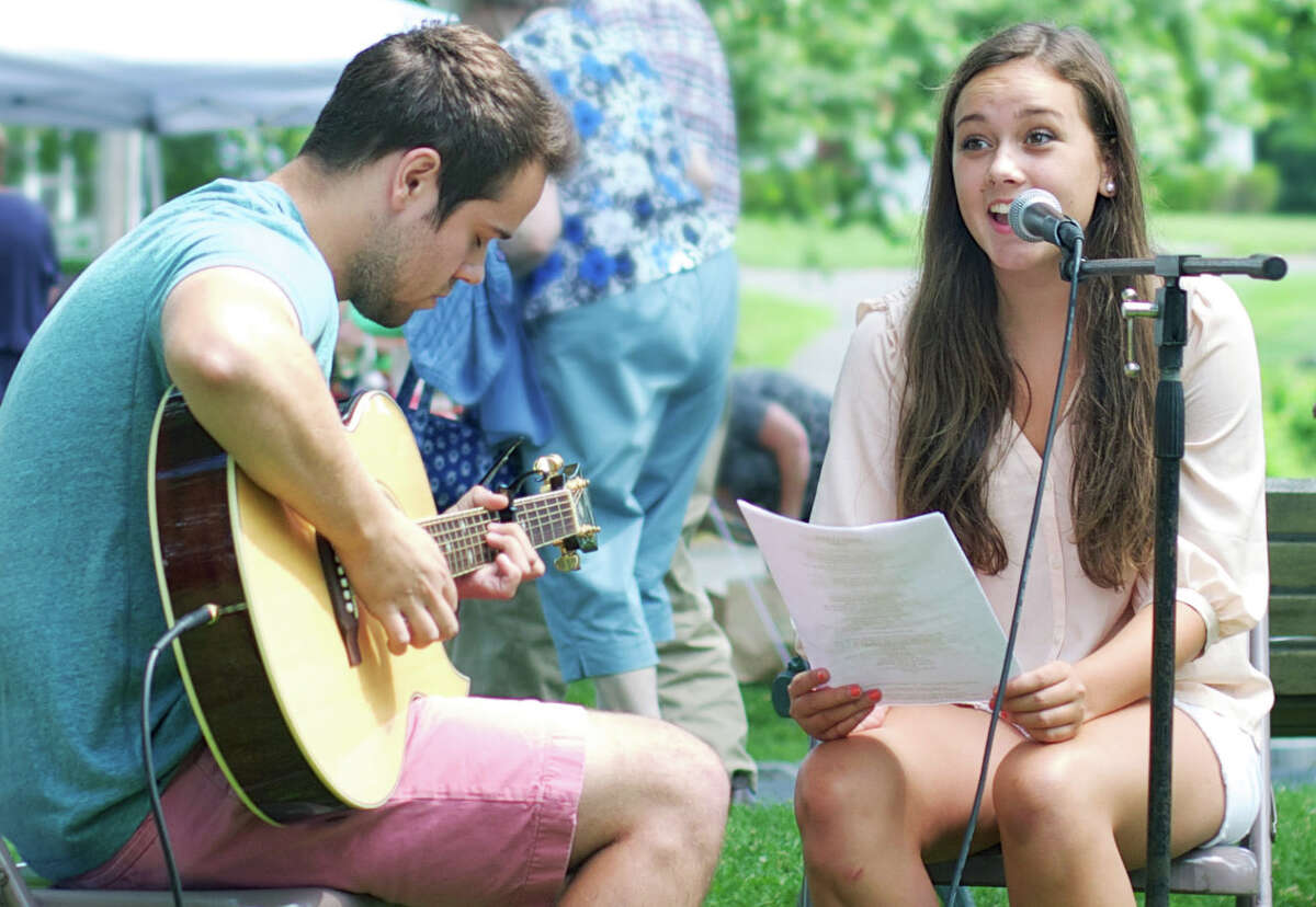 """Laura van Tartwijk of Washington performs """"Madness,"""" by Muse, accompanied on guitar by Harris Owens of New Preston during the Washington Green Fair, hosted July 12, 2014 by the First Congregational Church of Washington."""
